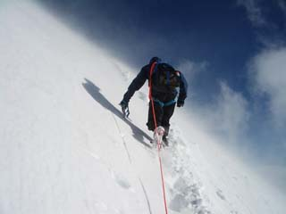 Ascending Rainier, photo by Buzz Burrell